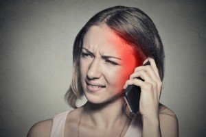 woman feeling pain from cell phone