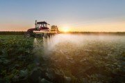 tractor spraying pesticides containing glyphosate