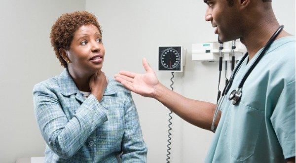 woman describing pain to her doctor