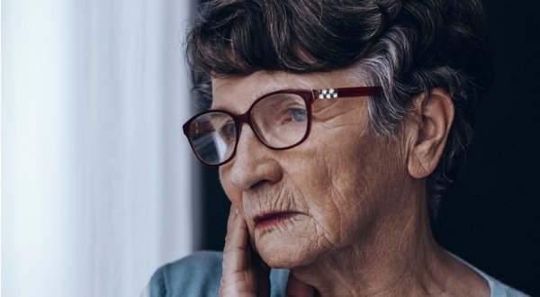 elderly woman pondering