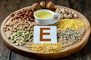 Good sources of vitamin E include olive oil, nuts, seeds and egg yolks.