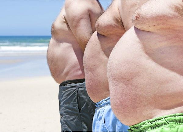 obese men on beach
