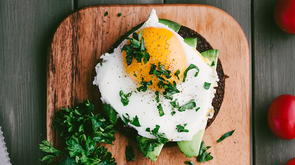 Fried egg with sliced Avocado on seed toast