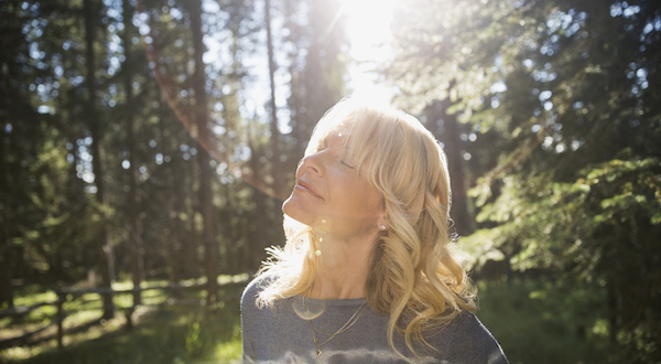 woman forest bathing in the sun