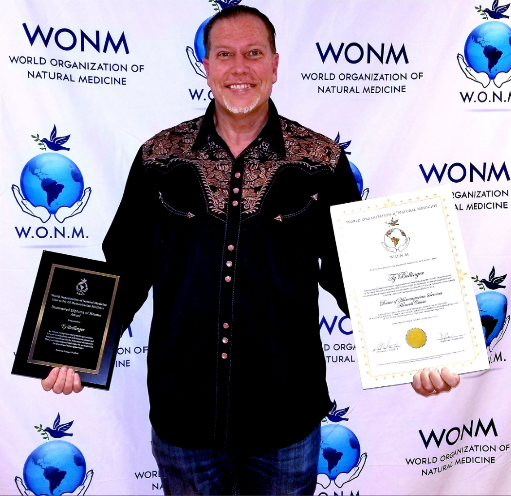 Ty Bollinger Accepting WONM Honorary Doctorate